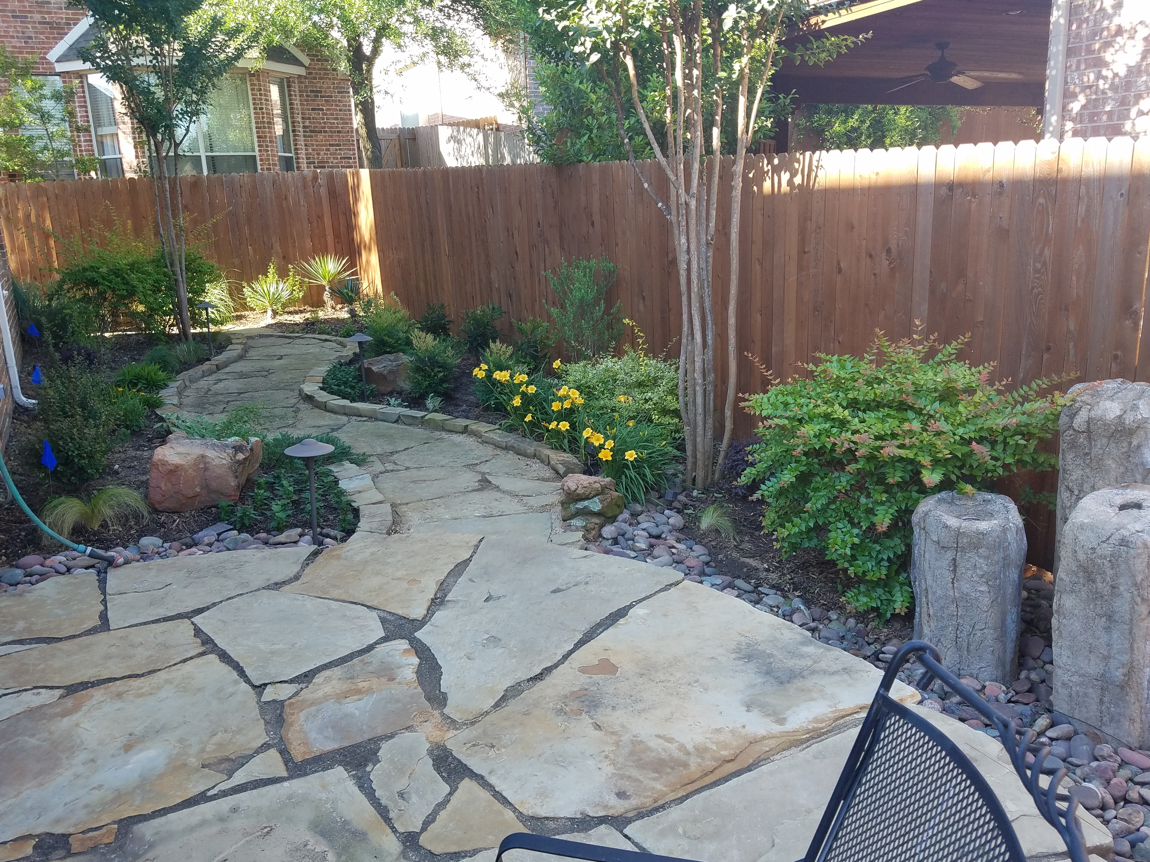 Flagstone Patio Installation - Fort Worth - Hardscapes ... on Rock Patio Designs id=73431